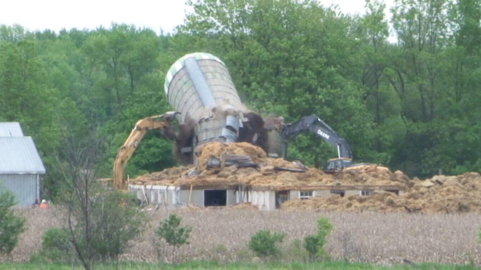 Frank Meyers' Trenton, Ont., farm is nearing its end, as silos and several buildings on his former farm were demolished Wednesday to make way for a new military camp.