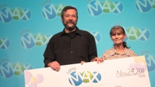 Don and Linda Ingram hold up a Lotto Max cheque for $50 million on Thursday, Nov. 24, 2011.