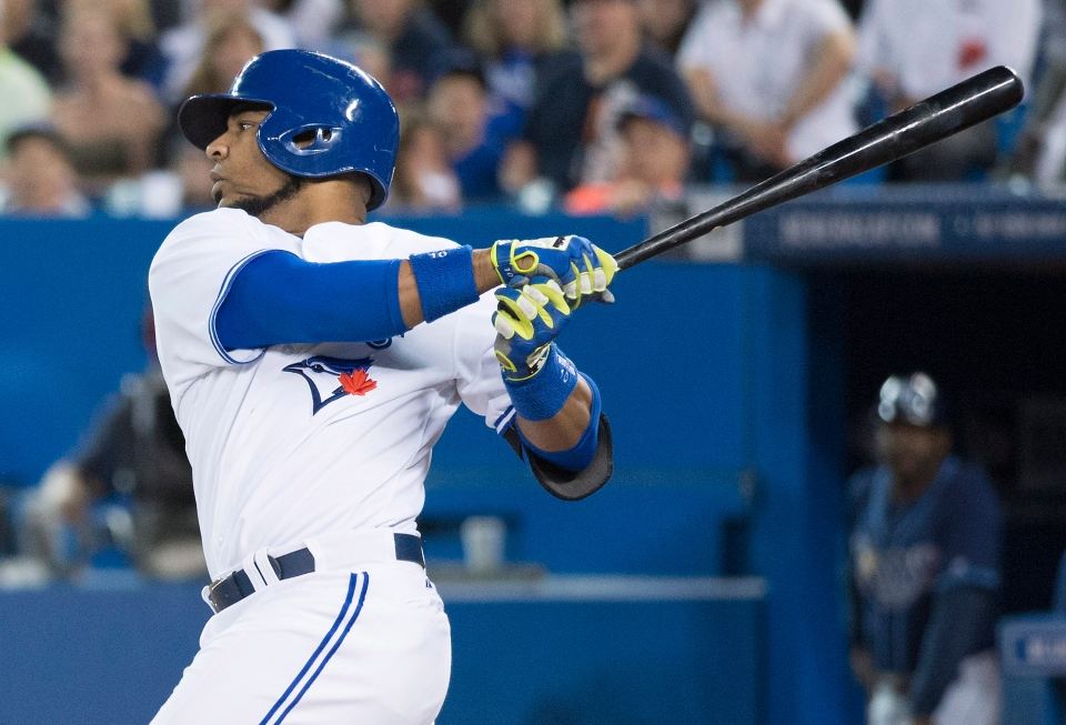 Toronto Blue Jays' Edwin Encarnacion hits a two-run single in the first inning of MLB baseball action against the Tampa Bay Rays in Toronto on Wednesday, May 28, 2014. THE CANADIAN PRESS/Darren Calabrese