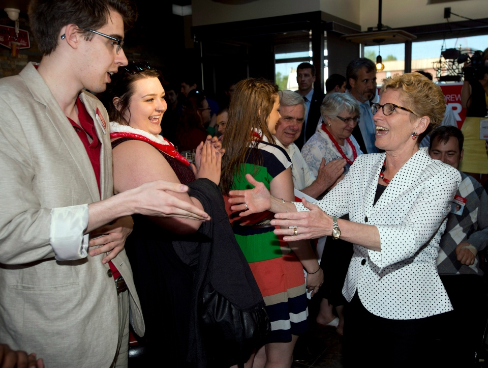 Liberal leader Kathleen Wynne greets supporters at a campaign event in Sudbury, Ont. (Frank Gunn / THE CANADIAN PRESS)
