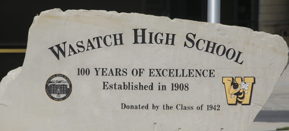 The Wasatch High School sign is shown Thursday, May 29, 2014, in Heber City, in Utah. A group of Utah high school students said they were shocked and upset to discover their school yearbook photos were digitally altered, with sleeves and higher necklines drawn on to cover up bare skin. (AP Photo/Rick Bowmer)