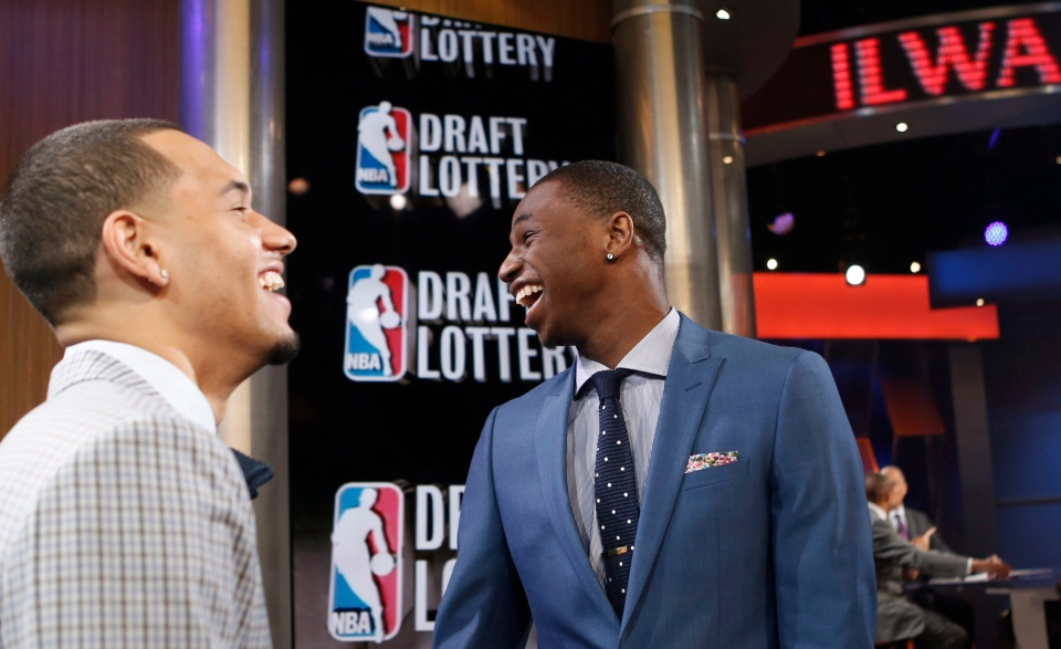 NBA draft prospects Tyler Ennis of Syracuse, left, and Andrew Wiggins of Kansas laugh before the NBA basketball draft lottery in New York, Tuesday, May 20, 2014. (AP Photo/Kathy Willens)