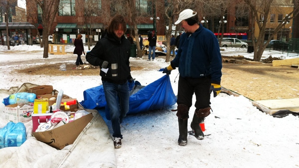 Occupy Edmonton protesters clear their belongs from a park in downtown Edmonton on Friday, Nov. 25, 2011. (Evan Klippenstein  / CTV News)