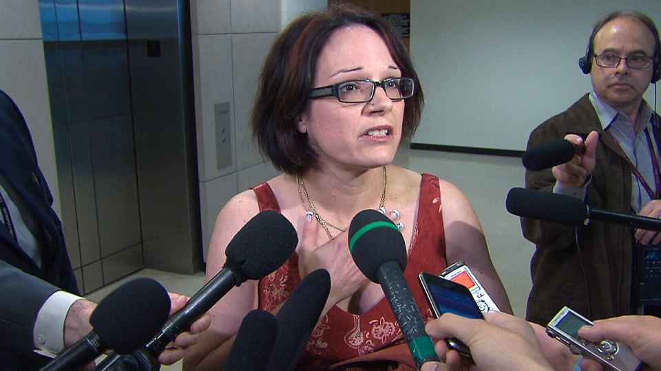 Jenny Migneault, the spouse of a veteran diagnosed with PTSD, speaks to reporters after confronting Veterans Affairs Minister Julian Fantino, in Ottawa, Thursday, May 29, 2014.
