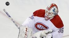 Montreal Canadiens goalie Dustin Tokarski (35) blo