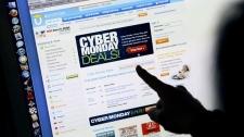 Consumer Carol Uyeno looks at Cyber Monday sales on her computer at her home in Palo Alto, Calif., Monday, Nov. 29, 2010. (AP Photo/Paul Sakuma)