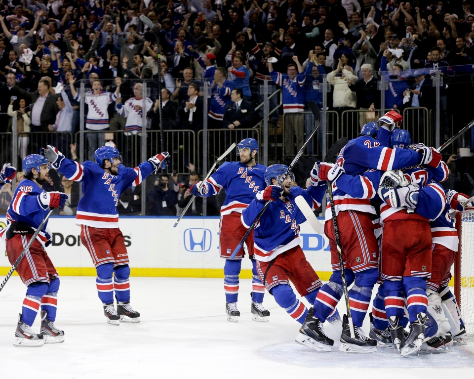 The New York Rangers celebrate after beating the Montreal Canadiens 1-0 in Game 6 of the NHL hockey Stanley Cup playoffs Eastern Conference finals, Thursday, May 29, 2014, in New York. The Rangers advance to the Stanley Cup Finals. (AP Photo/Julie Jacobson)