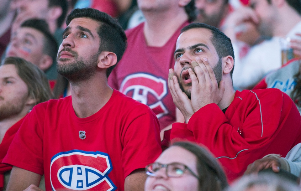 Montreal Canadiens fans react as they watch game six of the NHL Eastern Conference final Stanley Cup playoff game against the New York Rangers on the big screen at the Bell Centre in Montreal, Thursday, May 29, 2014.THE CANADIAN PRESS/Graham Hughes