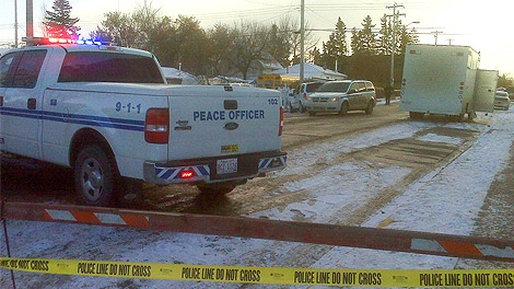 RCMP officers on the scene of a fatal explosion in Innisfail on Friday, November 25.