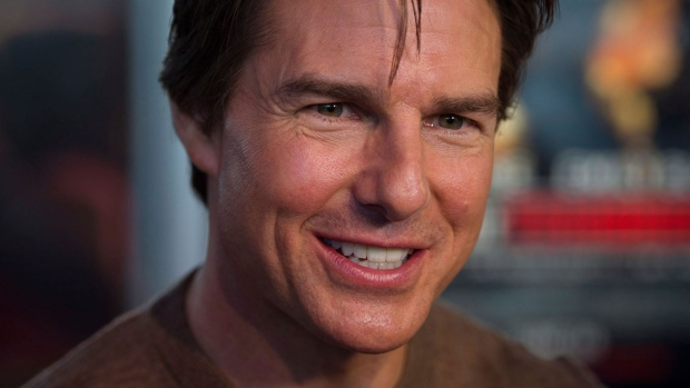 Actor Tom Cruise walks the red carpet at the premiere of his new film 'Edge of Tomorrow' in Toronto on Thursday, May 29, 2014. (Darren Calabrese / THE CANADIAN PRESS)