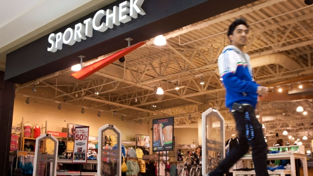 A shopper walks past a Sport Chek store in Calgary