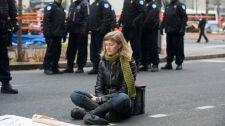 A protestor sits quietly at the occupy Montreal site as police move in and close down the camp in Montreal, Friday, November 25, 2011. THE CANADIAN PRESS/Graham Hughes