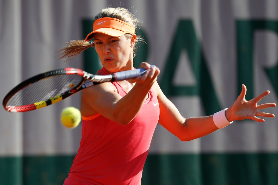 Canada's Eugenie Bouchard returns the ball during the third round match of the French Open tennis tournament against Sweden's Johanna Larsson at the Roland Garros stadium, in Paris, France, Friday, May 30, 2014. (AP Photo/David Vincent)