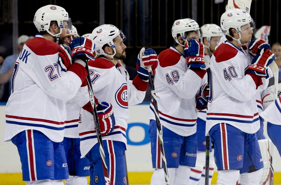 The Montreal Canadiens watch as the New York Rangers celebrate their 1-0 win in Game 6 of the NHL hockey Stanley Cup playoffs Eastern Conference finals, Thursday, May 29, 2014, in New York. The Rangers advance to the Stanley Cup Final. (AP Photo/Julie Jacobson)