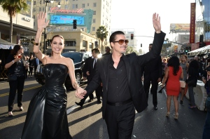 "In this Wednesday, May 28, 2014 file photo, Angelina Jolie, left, and Brad Pitt arrive at the world premiere of ""Maleficent"" at the El Capitan Theatre in Los Angeles. A man who accosted Pitt on a red carpet has pleaded no contest to battery and been ordered to stay away from the actor and Hollywood red carpet events. (Photo by John Shearer/Invision/AP, file)"