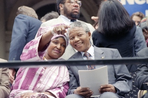 Winnie Mandela points out something in the crowd to her husband Nelson Mandela, during a welcoming ceremony at New York's City Hall in this photo taken June 20, 1990. (AP / David Longstreath)