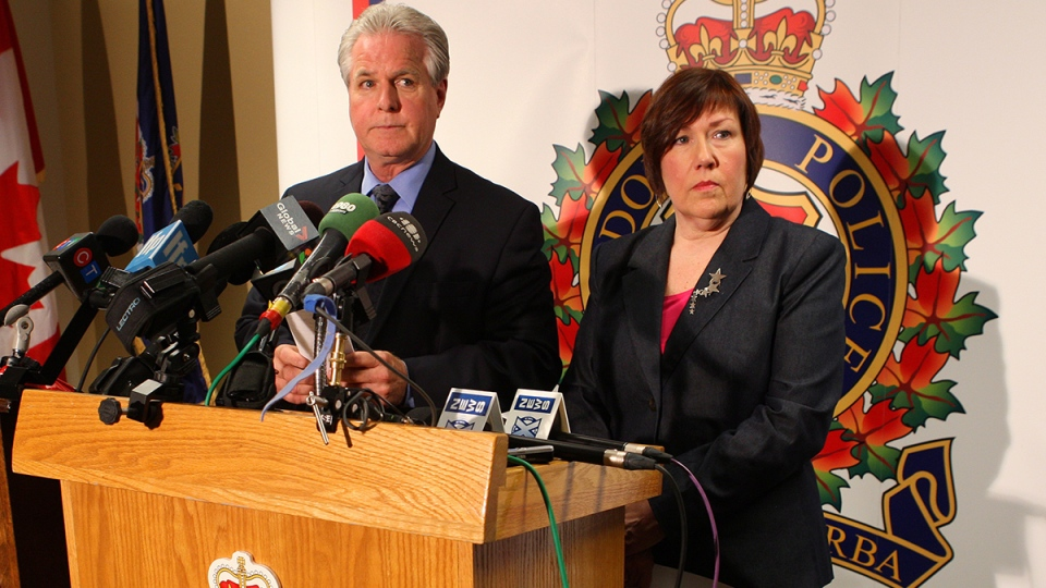 London Police Det. Insp. Kevin Heslop and Children's Aid Society of London and Middlesex Exec,. Director Jane Fitzgerald, gives details about a 10-year old boy who apparently was held captive in a bedroom, at a press conference at Police Headquarters in London, Ont., Friday, May 30, 2014. (Dave Chidley / THE CANADIAN PRESS)