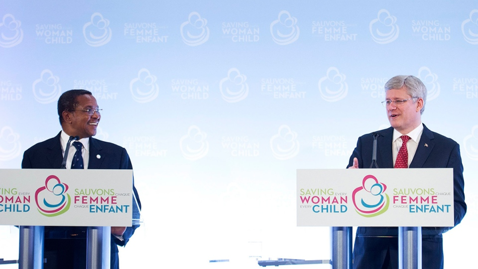 Prime Minister Stephen Harper, right, and Jakaya M. Kikwete President of the United Republic of Tanzania speak to the media during the closing news conference after attending the Maternal, Newborn and Child Health Summit in Toronto on Friday, May 30, 2014. (Nathan Denette / THE CANADIAN PRESS)