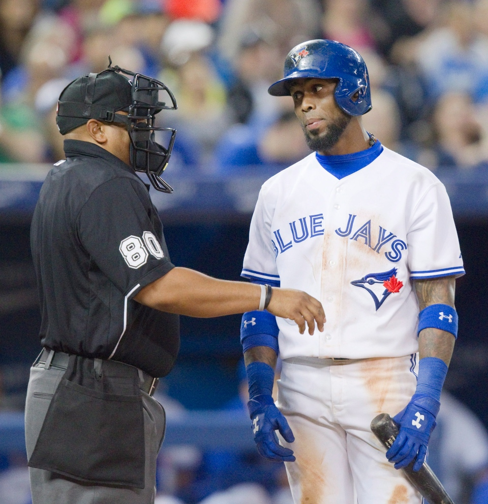 Toronto Blue Jays' Jose Reyes has words with home plate umpire Adrian Johnson after a called third strike during sixth inning AL baseball game action against the Kansas City Royals in Toronto Friday May 30, 2014. THE CANADIAN PRESS/Fred Thornhill