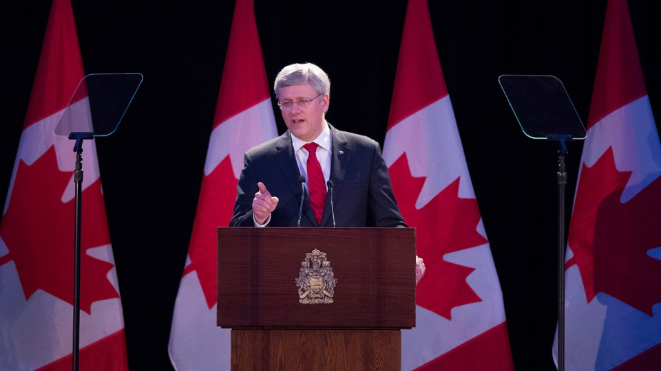 Prime Minister Stephen Harper addresses a fundraiser for a memorial to the victims of Communism in Toronto, Ont. on Friday, May 30, 2014. (THE CANADIAN PRESS/Darren Calabrese)