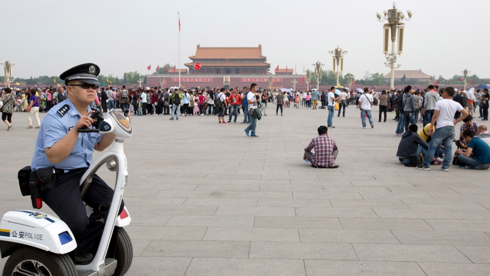 A policeman patrols on an electric personal transporter on Tiananmen Square in Beijing, China, May 17, 2014. (AP / Alexander F. Yuan)