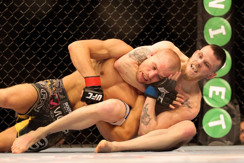 Niklas Backstrom from Sweden, right, fights Tom Niinimaki from Finland in a featherweight fight during the UFC Fight Night mixed martial arts event in Berlin, Saturday, May 31, 2014. Niklas Backstrom won the fight. (AP Photo/Markus Schreiber)