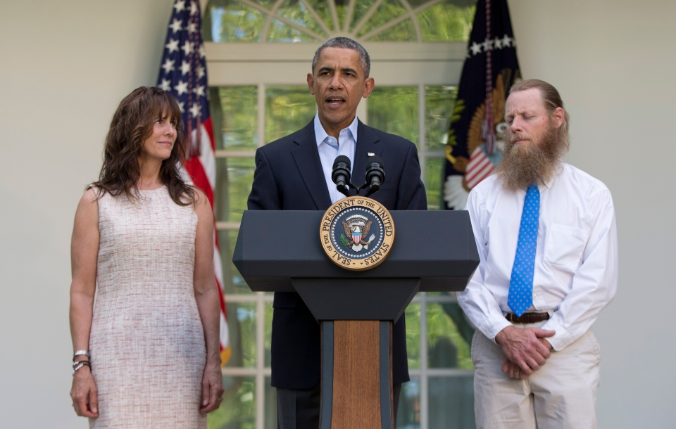 U.S. President Barack Obama speaks with Jani Bergdahl, left, and Bob Bergdahl, right, the parents of U.S. Army Sgt. Bowe Bergdahl, in the Rose Garden of the White House in Washington, Saturday, May 31, 2014, after the announcement that Bowe Bergdahl has been released from captivity. (Carolyn Kaster/AP)