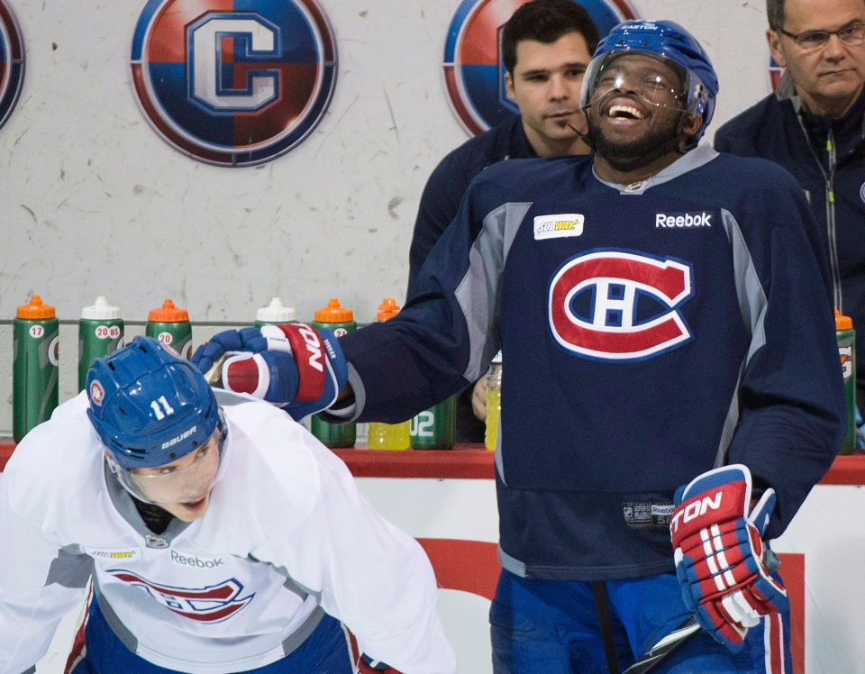 Montreal Canadiens' P.K. Subban, right, laughs alongside teammate Brendan Gallagher during a practice session in Brossard, Que., Monday, April 21, 2014, ahead of game four of first round NHL Stanley Cup playoff action against the Tampa Bay Lightning. THE CANADIAN PRESS/Graham Hughes