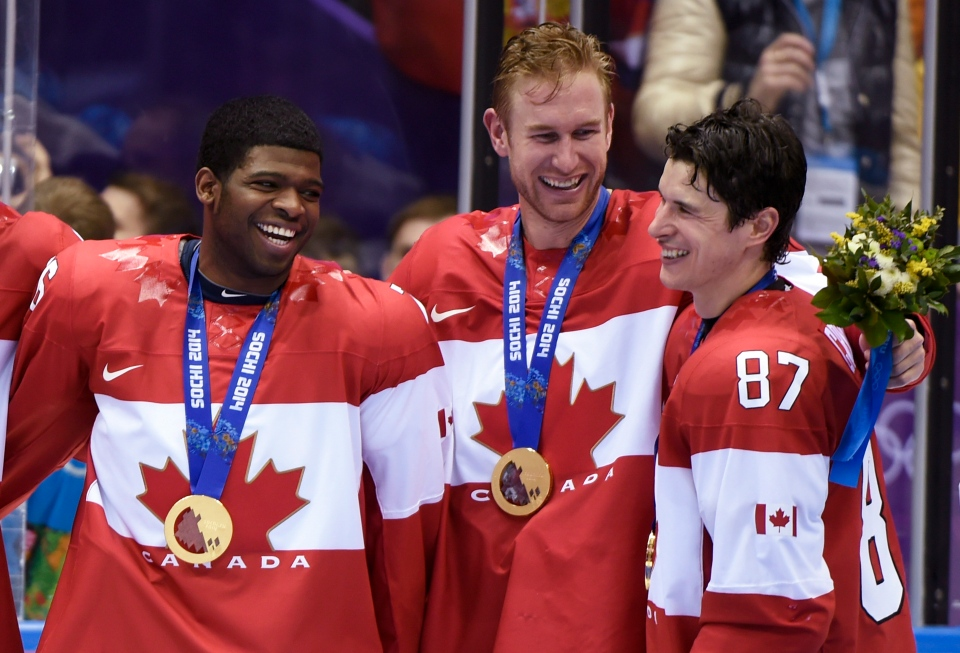 Men's hockey gold medalists P.K. Subban, Jeff Carter and Sidney Crosby, left to right, share a laugh during medal ceremonies after beating Sweden 3-0 in the final at the Sochi Winter Olympics Sunday, February 23, 2014 in Sochi. THE CANADIAN PRESS/Paul Chiasson