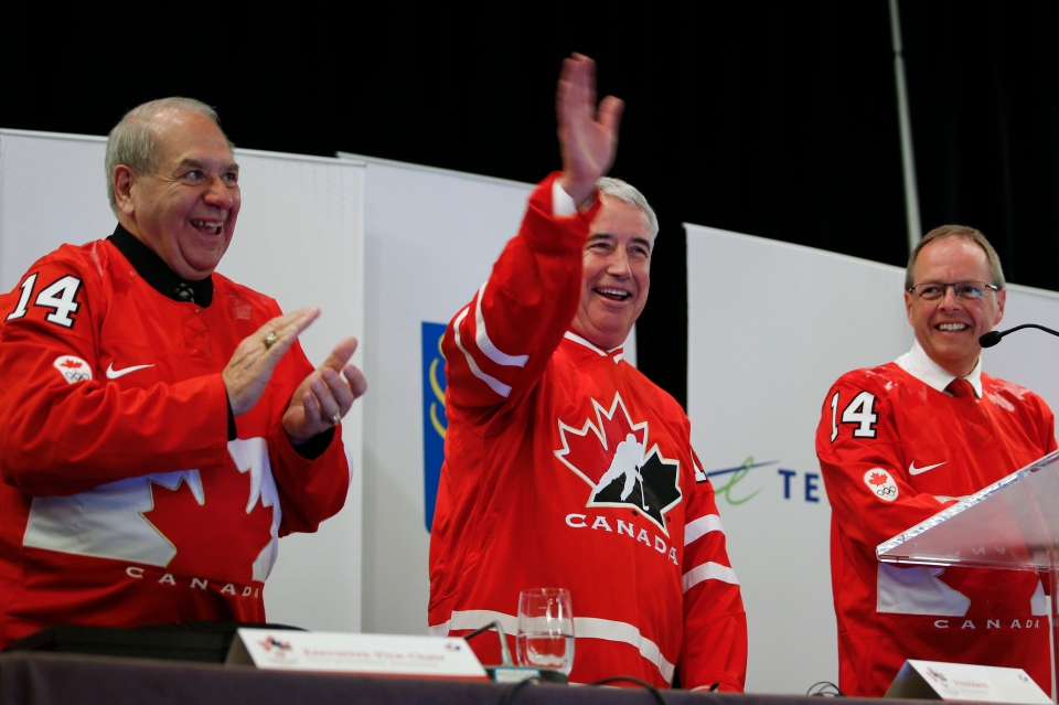 Hockey Canada president and CEO Bob Nicholson, centre, waves after announcing his retirement at the organizations annual meeting in Calgary, Saturday, May 31, 2014.THE CANADIAN PRESS/Jeff McIntosh