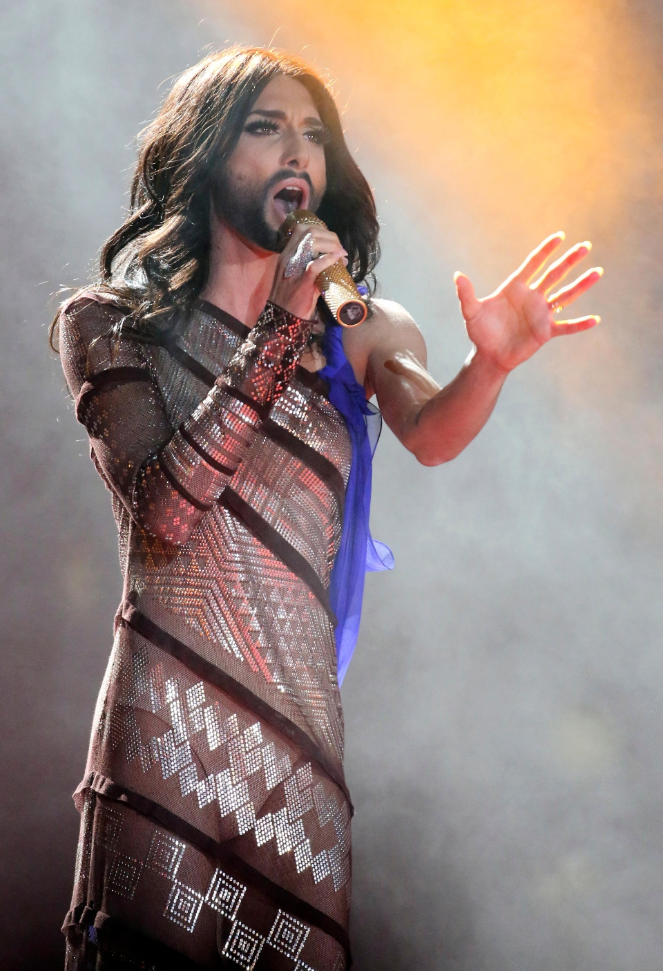 Austrian singer and Eurovision Song Contest winner Conchita Wurst performs on stage during the opening ceremony of the Life Ball in front of City Hall in Vienna, Austria, Saturday, May 31, 2014. (AP Photo/Ronald Zak)