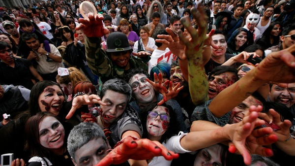 People dressed as zombies react to the camera during the V edition of the so-called 'Zombie Walk' in Mexico City, Saturday, Nov. 26, 2011. (AP / Marco Ugarte)