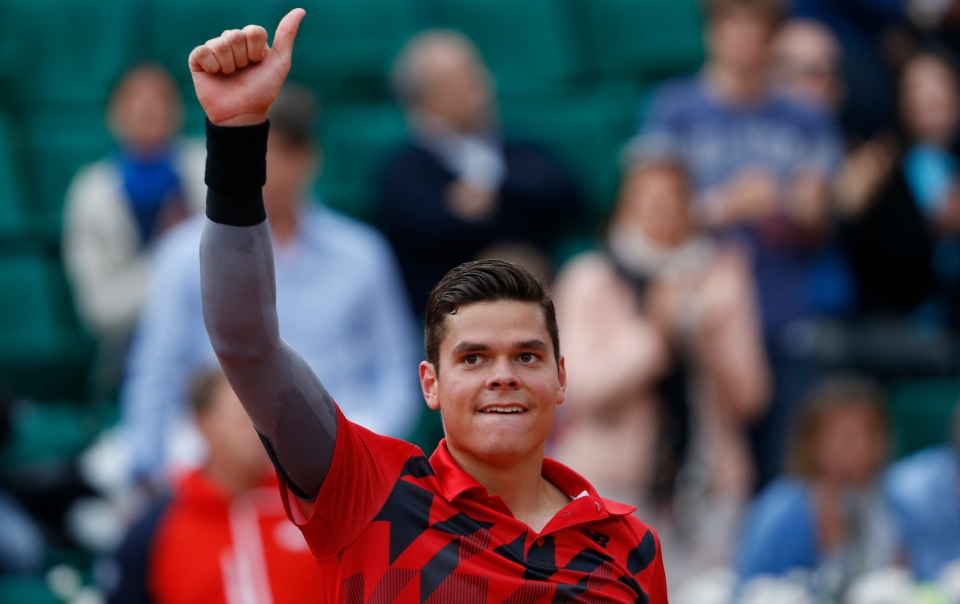 Canada's Milos Raonic celebrates winning the fourth round match of the French Open tennis tournament against Spain's Marcel Granollers at the Roland Garros stadium, in Paris, France on Sunday, June 1, 2014. Raonic won in three sets 6-3, 6-3, 6-3. (AP / Darko Vojinovic)