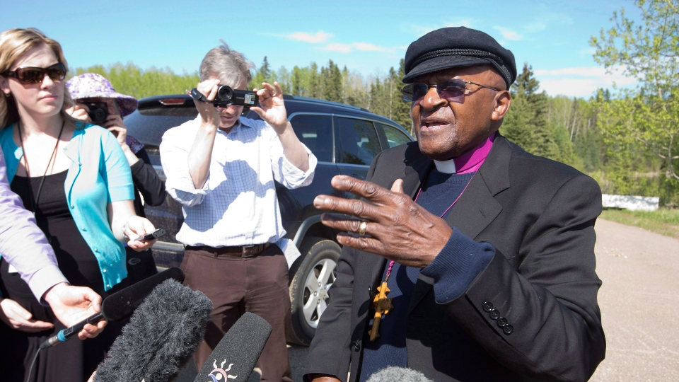 Archbishop Desmond Tutu speaks to media following a helicopter ride to take a look at the Oil Sands after he gave the keynote address at the conference, As Long as the Rivers Flow: Coming Back to the Treaty Relationship in Our Time, in Fort McMurray, Alberta on Saturday May 31, 2014. (Jason Franson / THE CANADIAN PRESS)