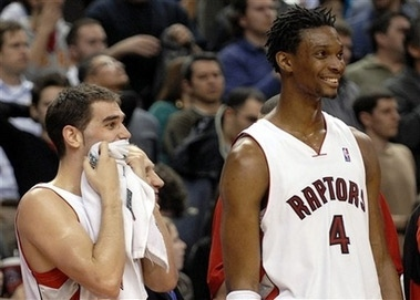 Toronto Raptors' Jose Calderon, left, and Chris Bosh (4) watch the final seconds of their game against the Charlotte Bobcats in Toronto Sunday, April 1, 2007. (AP /CP, Aaron Harris)
