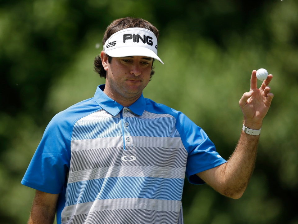 Bubba Watson acknowledges the patrons after making a putt on the second hole during the final round of the Memorial golf tournament on Sunday, June 1, 2014, in Dublin, Ohio. (AP Photo/Darron Cummings)