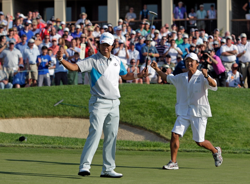 Hideki Matsuyama, left, of Japan, celebrates after winning the Memorial golf tournament in a playoff on Sunday, June 1, 2014, in Dublin, Ohio. (AP Photo/Jay LaPrete)