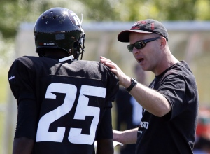 Ottawa Redblacks head coach Rick Campbell speaks with Brandyn Thompson at the first day of CFL training camp at Keith Harris Stadium in Ottawa on Sunday, June 1, 2014. THE CANADIAN PRESS/ Patrick Doyle