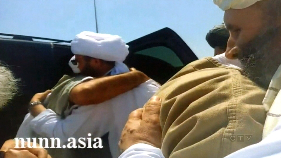 The Taliban released video and photos of the five former Guantanamo detainees arriving in Qatar.