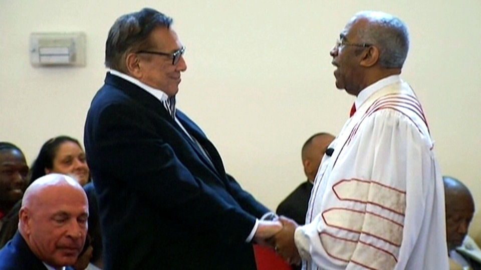 Donald Sterling stands up in Praises of Zion Missionary Baptist Church in Los Angeles, Sunday, June 1, 2014.