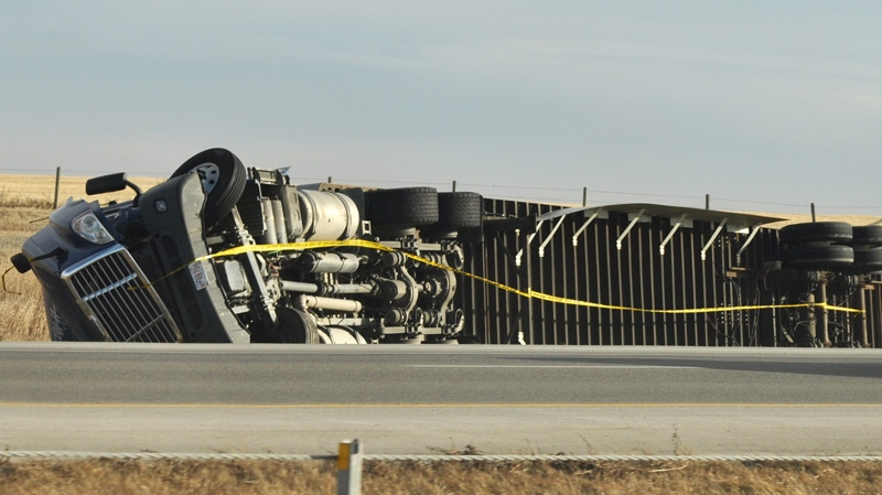 A semi-trailer truck rollover on the QE2 southbound near Airdrie, Alta. on Sunday, Nov. 27, 2011. (Kellie Babin / MyNews.CTV.ca)