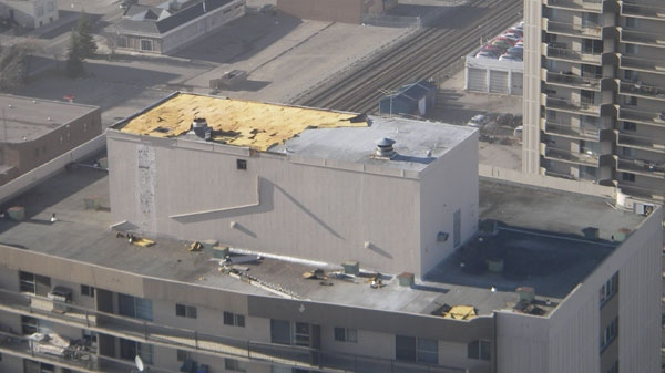 Strong winds stripped the roof of the Continental Towers in Calgary, Alta., Sunday, on Sunday. Nov. 27, 2011. (Carrie Peciulis)