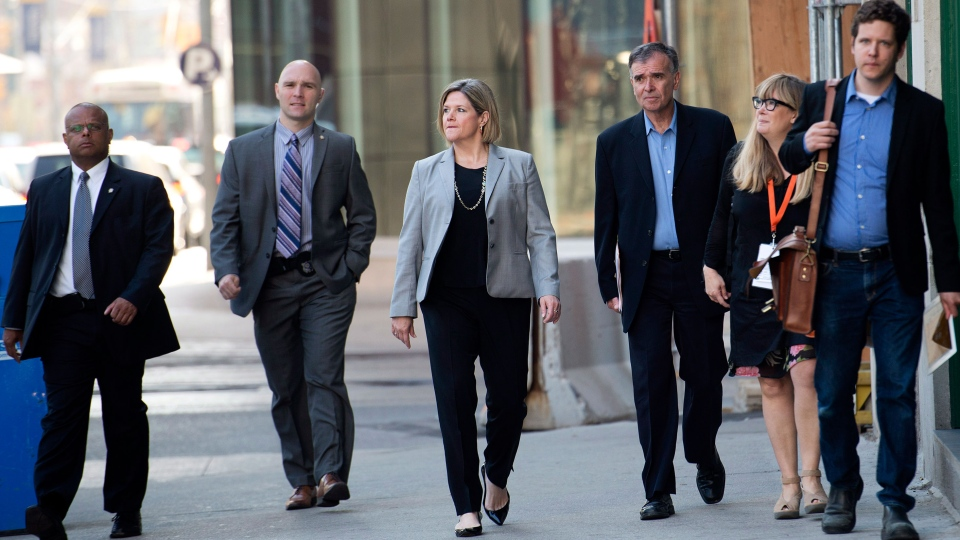 NDP leader Andrea Horwath, centre, walks with her team as she makes her way to talk with the media after a campaign stop in Toronto on Monday, June 2, 2014. (Nathan Denette / THE CANADIAN PRESS)
