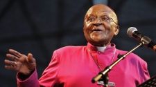South African Archbishop Desmond Tutu speaks during a climate justice rally held in Durban, South Africa, Sunday, Nov 27, 2011, ahead of the official start or a two-week international climate conference with about 190 countries beginning upcoming Monday. (AP Photo/Schalk van Zuydam)