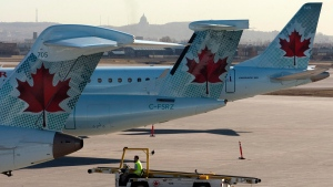 Air Canada planes on the tarmac at Pierre Trudeau airport in Montreal on March 23, 2012. (THE CANADIAN PRESS / Ryan Remiorz)