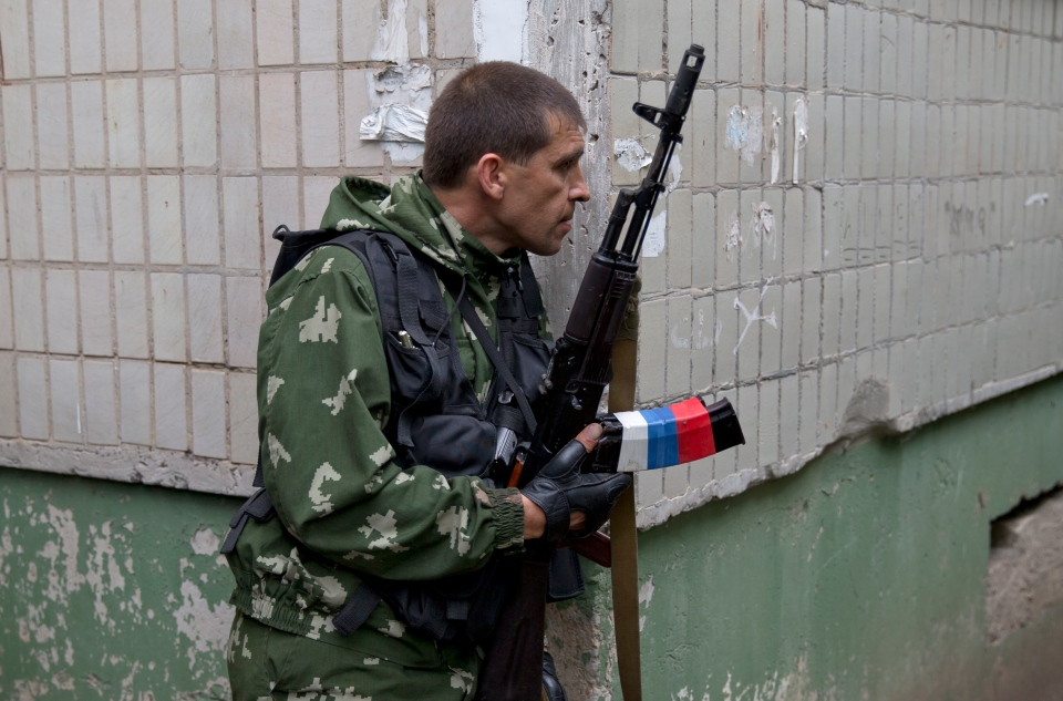 A pro-Russian holds his weapon during clashes with Ukrainian troops on the outskirts of Luhansk, Ukraine on Monday, June 2, 2014. (AP / Vadim Ghirda)