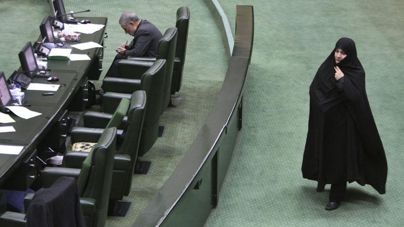 An unidentified Iranian female lawmaker walks through the parliament in Tehran, Iran, Sunday, Nov. 27, 2011.