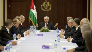 Palestinian President Mahmoud Abbas, centre, meets with cabinet members of its unity government, including Prime Minister Rami Hamdallah, centre left, in the West Bank city of Ramallah on Monday, June 2, 2014. (AP / Majdi Mohammed)