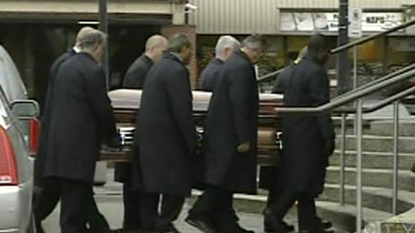 Pallbearers carry Salvatore Montagna's casket into Our Lady of Pompei church (Nov. 28, 2011)