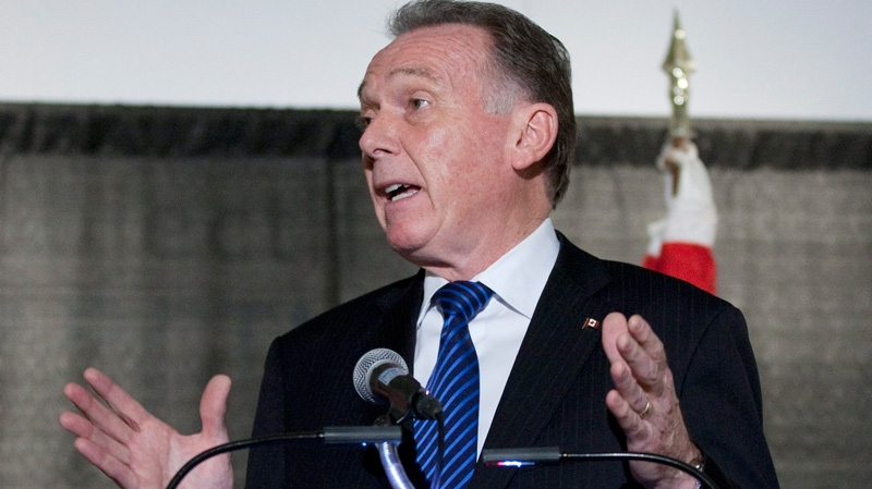 Environment Minister Peter Kent holds a news conference in Ottawa, as he prepares to leave for climate talks in Durban later this week, on Monday Nov. 28, 2011. (Fred Chartrand / THE CANADIAN PRESS)